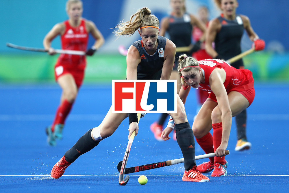 RIO DE JANEIRO, BRAZIL - AUGUST 19:  Lily Owsley of Great Britain and Caia van Maasakeeer of Netherlands in action on Day 14 of the Rio 2016 Olympic Games at the Olympic Hockey Centre on August 19, 2016 in Rio de Janeiro, Brazil.  (Photo by David Rogers/Getty Images)
