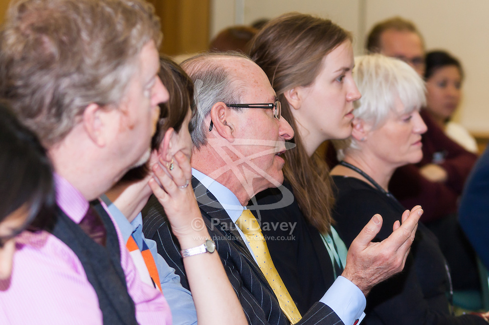 Portcullis House, Westminster, London, January 14th 2014. Members of the Residential Landlords Association attend the launch of their Policy Manifesto and hear views from MPs. PICTURED: A member of the audience raises a question for the panel.