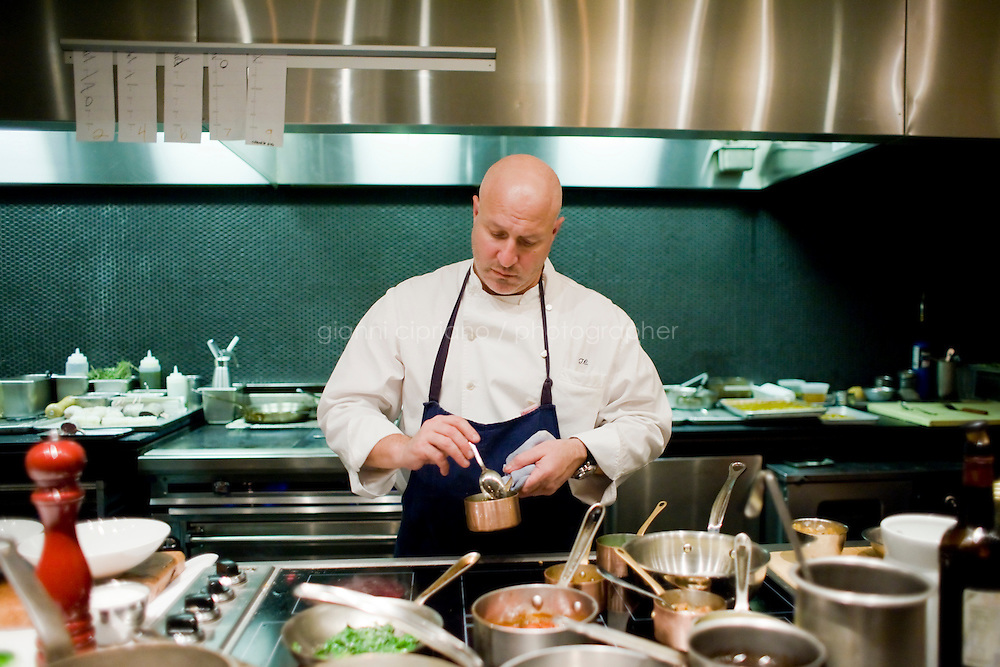 """9 December, 2008. New York, NY. Tom Collichio at Craft is """"on stage"""" for customers in the open kitchen of Craft's dining room, a New York restaurant. Several restaurants offer special seatings with their celebrity chefs.<br /> <br /> ©2008 Gianni Cipriano for The New York Times<br /> cell. +1 646 465 2168 (USA)<br /> cell. +1 328 567 7923 (Italy)<br /> gianni@giannicipriano.com<br /> www.giannicipriano.com"""