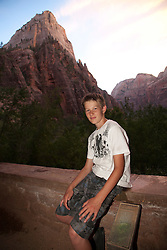 North America, United States, Utah, Zion National Park, boy (age 12) and mountain.  MR