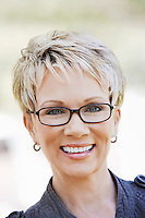 Elegant mature woman wearing glasses portrait