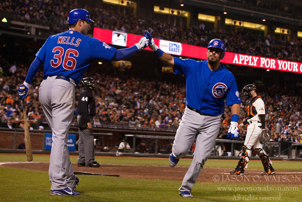 August 29, 2011; San Francisco, CA, USA;  Chicago Cubs catcher Geovany Soto (right) is congratulated by starting pitcher Randy Wells (36) after hitting a home run against the San Francisco Giants during the seventh inning at AT&T Park.