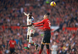 MANCHESTER, ENGLAND - Sunday, February 24, 2019: Liverpool's Sadio Mane (L) and Manchester United's Chris Smalling during the FA Premier League match between Manchester United FC and Liverpool FC at Old Trafford. (Pic by David Rawcliffe/Propaganda)