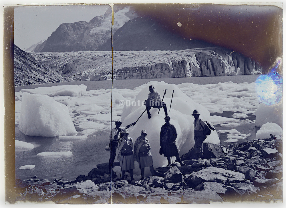 broken glass plate with early tourism on ice glacier