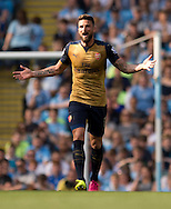 Olivier Giroud of Arsenal remonstrates with Referee Anthony Taylor during the Barclays Premier League match at the Etihad Stadium, Manchester<br /> Picture by Russell Hart/Focus Images Ltd 07791 688 420<br /> 08/05/2016