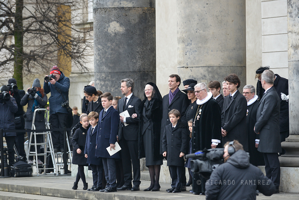 20.02.2018. Copenhagen, Denmark. <br /> The royal family outside at Christiansborg Palace Church. <br /> Crown Princess Mary,  Crown Prince Frederik, Princess Isabella, Princess Josephine, Prince Vincent, Prince Christian, Queen Margrethe, Prince Joacim, Princess Marie, Prince Nikolai, Prince Felix, Prince Henrik, Princess Athena, Royal priest Erik Nordmand Svendsen after the funeral service.<br /> Prince Henrik's coffin is carried out of the church and placed in the hearse.<br /> Photo: Ricardo Ramirez.