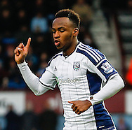 Saido Berahino of West Bromwich Albion celebrates scoring his team's first goal to make it 1-1 during the Barclays Premier League match at the Boleyn Ground, London<br /> Picture by David Horn/Focus Images Ltd +44 7545 970036<br /> 01/01/2015