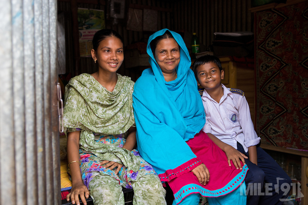 Kohinur with her son and daughter in their home in Dhaka, Bangladesh. <br /> <br /> Kohinur is a garment worker living and working in Dhaka Bangladesh.