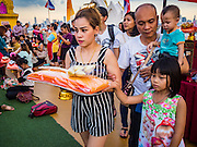 21 NOVEMBER 2015 - BANGKOK, THAILAND: People walk around the chedi with donations for the temple at the Wat Saket temple fair. Wat Saket is on a man-made hill in the historic section of Bangkok. The temple has golden spire that is 260 feet high which was the highest point in Bangkok for more than 100 years. The temple construction began in the 1800s in the reign of King Rama III and was completed in the reign of King Rama IV. The annual temple fair is held on the 12th lunar month, for nine days around the November full moon. During the fair a red cloth (reminiscent of a monk's robe) is placed around the Golden Mount while the temple grounds hosts Thai traditional theatre, food stalls and traditional shows.     PHOTO BY JACK KURTZ