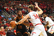LUBBOCK, TX - MARCH 1: Matthew Temple #34 of the Texas Tech Red Raiders knocks the ball away from Shaquille Cleare #32 of the Texas Longhorns during the game on March 1, 2017 at United Supermarkets Arena in Lubbock, Texas. Texas Tech defeated Texas 67-57. (Photo by John Weast/Getty Images) *** Local Caption *** Matthew Temple;Shaquille Cleare