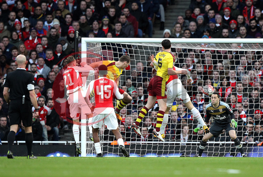 Sam Vokes of Burnley scores a header to equalise against Arsenal in The FA Cup tie - Mandatory byline: Robbie Stephenson/JMP - 30/01/2016 - FOOTBALL - Emirates Stadium - London, England - Arsenal v Burnley - FA Cup Forth Round