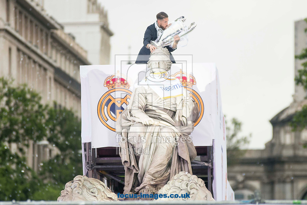 Real Madrid players celebrate winning the UEFA Champions League with an open top bus tour at Cibeles Square, Madrid<br /> Picture by EXPA Pictures/Focus Images Ltd 07814482222<br /> 29/05/2016<br /> ***UK &amp; IRELAND ONLY***<br /> EXPA-ESP-160529-0126.jpg