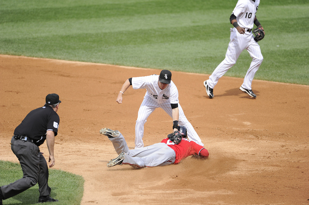 CHICAGO - JUNE 25:  Gordon Beckham #15 of the Chicago White Sox tags out Roger Bernadina #2 of the Washington Nationals while attempting to steal second base in the third inning on June 25, 2011 at U.S. Cellular Field in Chicago, Illinois.  The White Sox defeated the Nationals 3-0.  (Photo by Ron Vesely)   Subject:  Gordon Beckham;Roger Bernadina