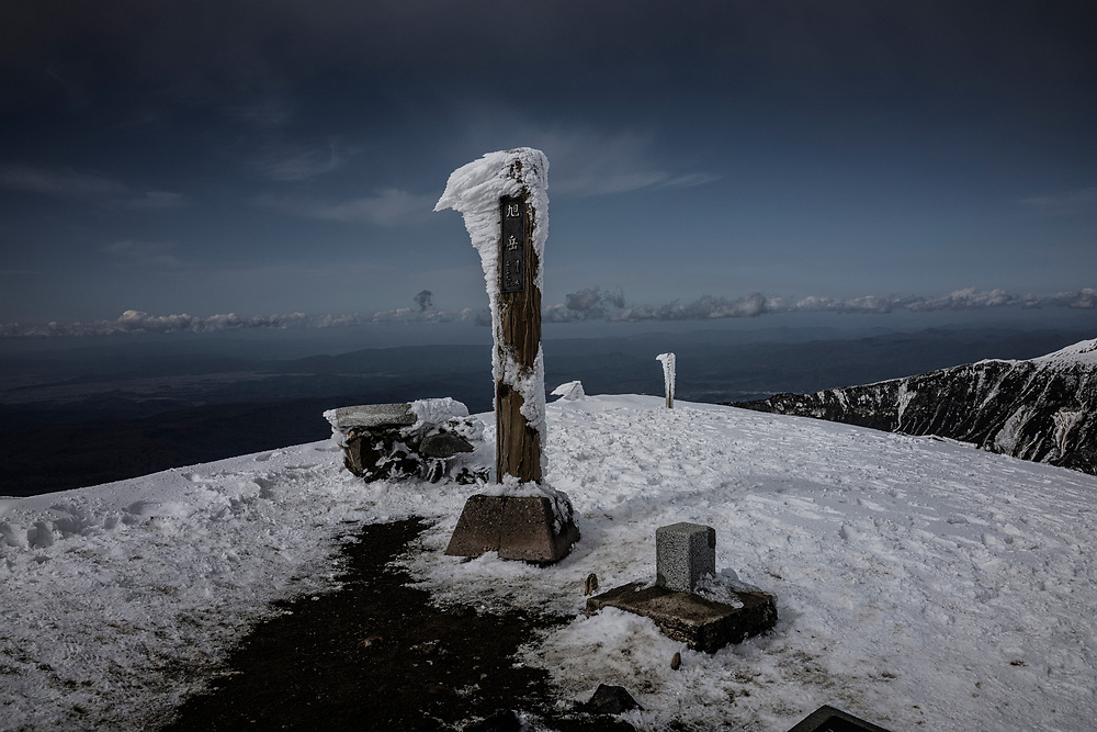 Rime ice accumulates on the summit marker for  Mt. Asahidake, the northern island of Hokkaido's highest mountain.  Last night, it experienced Japan's snowfall this year.  This active volcano is part of Japan's largest national park, Daisetsuzan National Park and it in the region known to be the coldest in all Japan.