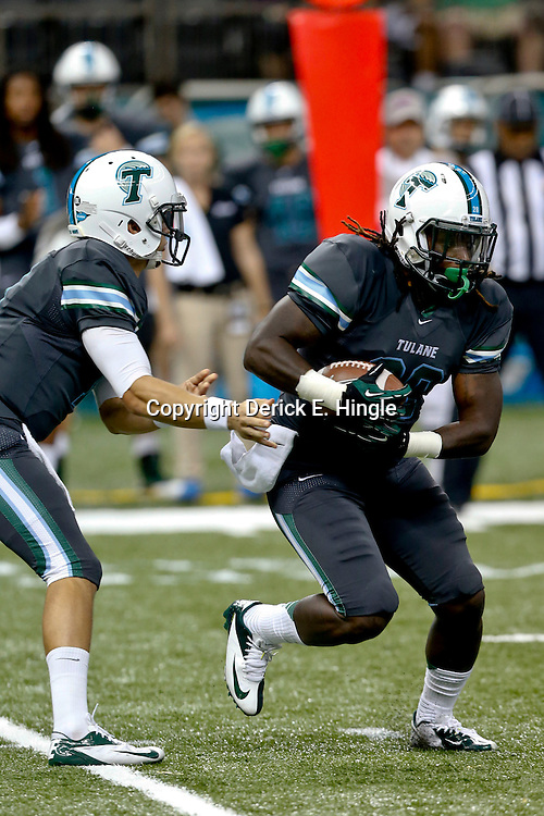Sep 7, 2013; New Orleans, LA, USA; Tulane Green Wave running back Rob Kelley (28) gets the handoff from quarterback Nick Montana during the first quarter of a game against the South Alabama Jaguars at the Mercedes-Benz Superdome. Mandatory Credit: Derick E. Hingle-USA TODAY Sports