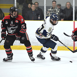 TORONTO, ON  - APR 10,  2018: Ontario Junior Hockey League, South West Conference Championship Series. Game seven of the best of seven series between Georgetown Raiders and the Toronto Patriots. Justin Paul #25 of the Georgetown Raiders and Colton Kalezic #27 of the Toronto Patriots pursue the play during the third period.<br /> (Photo by Andy Corneau / OJHL Images)