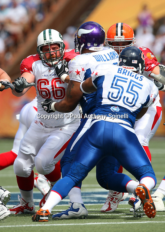HONOLULU, HI - FEBRUARY 08: AFC All-Stars guard Alan Faneca #66 of the New York Jets blocks defensive tackle Pat Williams #94 of the Minnesota Vikings of the NFC All-Stars in the 2009 NFL Pro Bowl at Aloha Stadium on February 8, 2009 in Honolulu, Hawaii. The NFC defeated the AFC 30-21. ©Paul Anthony Spinelli *** Local Caption *** Alan Faneca;Pat Williams