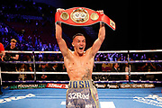 Josh Warrington celebrates winning the fight holding the world title belt after during the Josh Warrington Sofiane Takoucht IBF featherweight title fight at First Direct Arena, Leeds, United Kingdom on 12 October 2019.