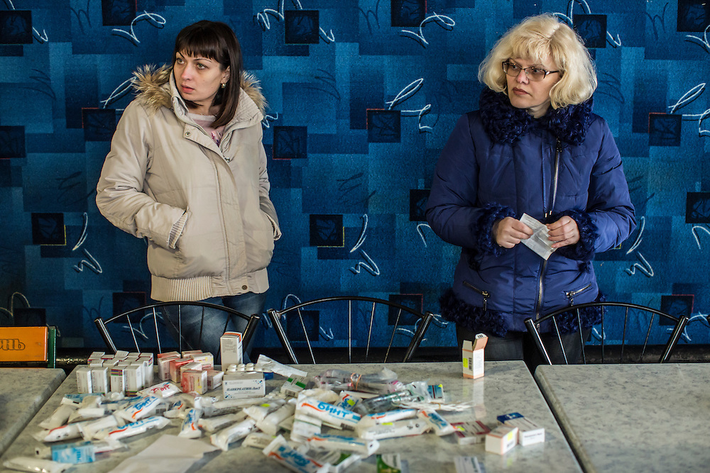 SHAKTORSK, UKRAINE - JANUARY 31, 2015: Women sort medical supplies which will be delivered to rebels fighting against Ukrainian troops in Shaktorsk, Ukraine. Fighting in Ukraine has intensified over the last week, with rebels declaring the end of a September ceasefire. CREDIT: Brendan Hoffman for The New York Times