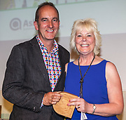 Kevin McCloud, author, broadcaster and designer presenting  Susan Osbourne of University Hospital of South Manchester NHS Foundation Trust with an Ashden award. The 2012 Ashden Awards for sustainable energy ceremony at the Royal Geographical Society. London.