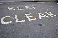 Close-Up of road marking saying Keep Clear in London, UK