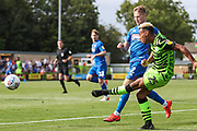 Forest Green Rovers Junior Mondal(25) crosses the ball during the EFL Sky Bet League 2 match between Forest Green Rovers and Grimsby Town FC at the New Lawn, Forest Green, United Kingdom on 17 August 2019.