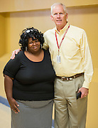 Uranda Adigun and Mike Lunceford pose for a photograph at the Global Graduate Family Learning Academy at Long Academy, October 17, 2015.
