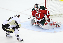 Mar 17; Newark, NJ, USA; New Jersey Devils goalie Martin Brodeur (30) makes a save on Pittsburgh Penguins right wing Pascal Dupuis (9) during the third period at the Prudential Center. The Penguins defeated the Devils 5-2.