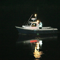 The Perth Harbour master boat searching the pitch black River Tay around Friarton Bridge after it was reported that a man jumped into the river from the Queens Bridge.<br />Picture by Graeme Hart.<br />Copyright Perthshire Picture Agency<br />Tel: 01738 623350  Mobile: 07990 594431