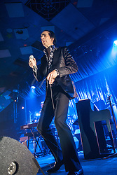 A wide angle shot of the frontman Nick Cave back to the stage, Nick Cave and the Bad Seeds, on stage tonight at The Barrowlands, Glasgow, Scotland.<br /> &copy;Michael Schofield.