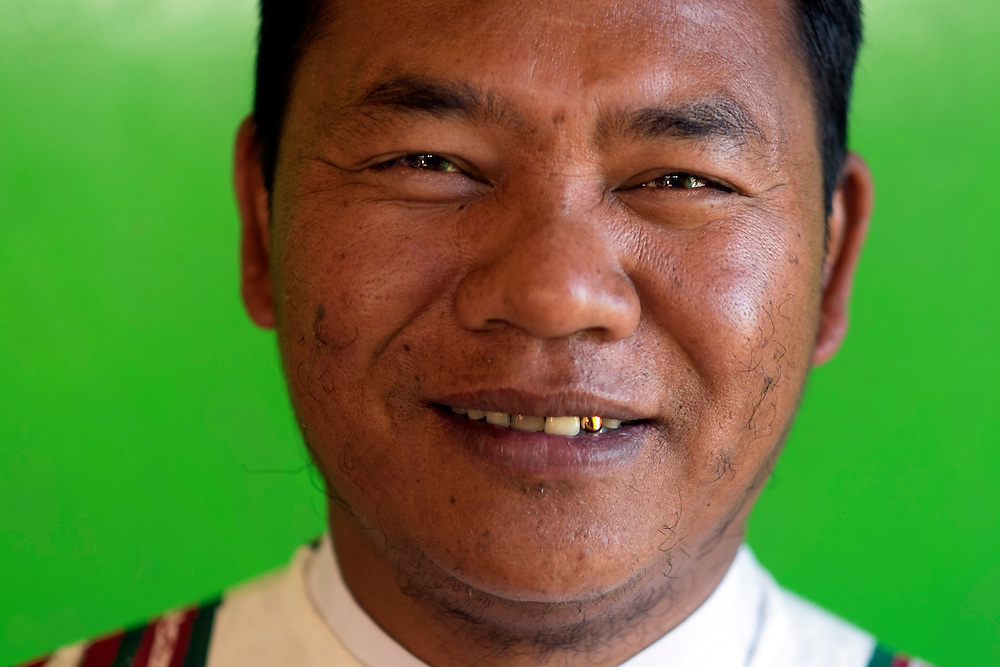 The prophet pose for a portrait in Tedim village.<br /> They believe in a supreme God called Pasian and a prophet called Pa Kam Suan Mang who is alive and lead the cult from a Siangswan village in Tedim township.