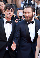 Jake Gyllenhaal and Devon Bostic at the Okja gala screening,  at the 70th Cannes Film Festival Friday 19th May 2017, Cannes, France. Photo credit: Doreen Kennedy
