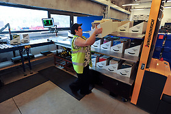 © London News Pictures. 2011/01/14 .A worker processes books. The Bodleian Book Storage Facility (BSF) in Swindon, UK,  'ingests' its one millionth item, the book 'Journal of General Physiology Volume 1 1918-1919' on Friday, 14 January 2011. It has been achieved in just under three months and has required an average daily ingest rate of 19,000 books and periodicals per day by 32 staff. On peak days, and depending on the materials, as many as 42,000 items have been ingested. . Picture credit should read Stephen Simpson/LNP