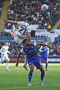 Swansea City midfielder Matt Grimes (21) beats Ipswich Town midfielder Grant Ward (18) to the ball during the EFL Sky Bet Championship match between Swansea City and Ipswich Town at the Liberty Stadium, Swansea, Wales on 6 October 2018.
