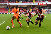 Reading FC forward Modou Barrow (17) ,Sheffield United defender Enda Stevens (3) and Sheffield United defender Jack O'Connell (5)  during the EFL Sky Bet Championship match between Sheffield Utd and Reading at Bramall Lane, Sheffield, England on 21 October 2017. Photo by Ian Lyall.