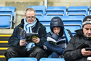 Wycombe Wanderers fans read the match day programme ahead of the EFL Sky Bet League 2 match between Wycombe Wanderers and Carlisle United at Adams Park, High Wycombe, England on 3 February 2018. Picture by Stephen Wright.