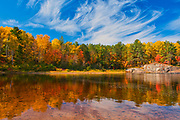 Reflection on the Aux Sables River in autumn<br />Chutes Provincial Park<br />Ontario<br />Canada