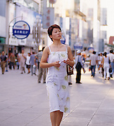 Woman in Yinchuan in modern shopping Mall.  Ningxia Province, China.