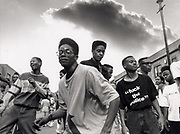 Group of men at Notting Hill Carnival dressed in Hip Hop clothing, 1990.