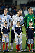 Scotland's Liam Kelly and mascot - Scotland v Holland - UEFA U21 European Championship qualifier at St Mirren Park..© David Young - .5 Foundry Place - .Monifieth - .Angus - .DD5 4BB - .Tel: 07765 252616 - .email: davidyoungphoto@gmail.com.web: www.davidyoungphoto.co.uk