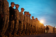 Apr, 9, 2011, Camp Edwards, Massachusetts - Cadets stand in formation at sunset. Photo by ©Lathan Goumas.