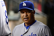 PHOENIX, AZ - JUNE 14:  Dave Roberts #30 of the Los Angeles Dodgers reacts in the dugout during the game against the Arizona Diamondbacks at Chase Field on June 14, 2016 in Phoenix, Arizona. Los Angeles Dodgers won 7-4.  (Photo by Jennifer Stewart/Getty Images)