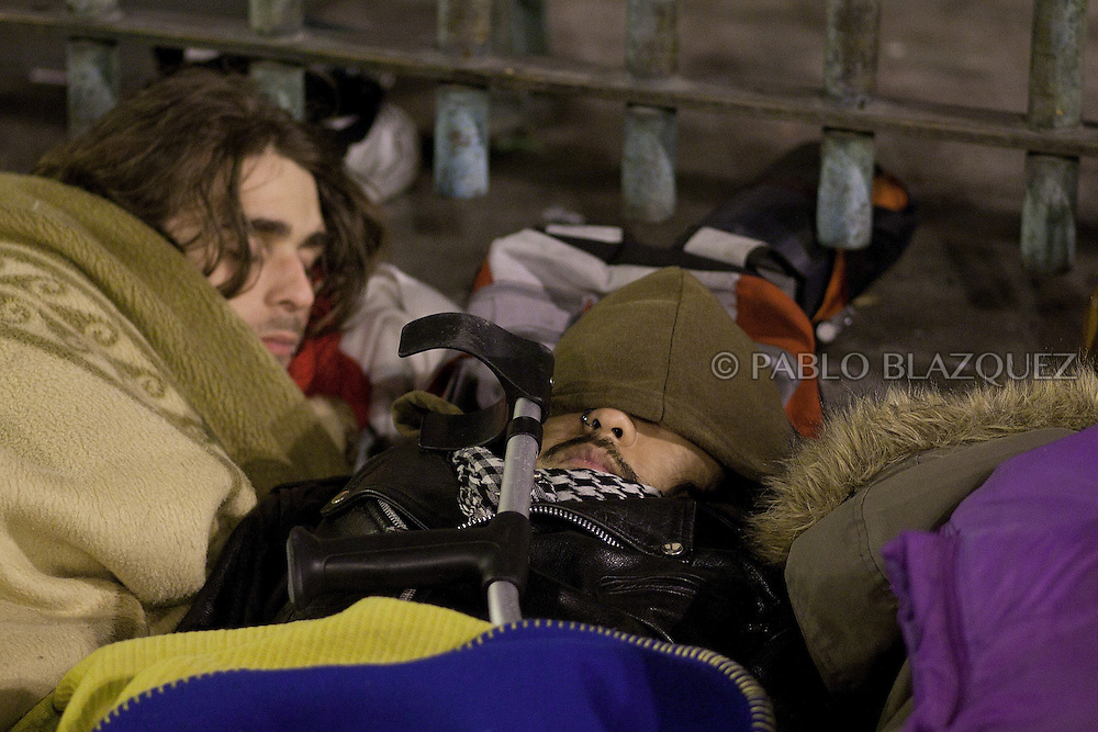 Demonstrators sleep the second night of a camp protest in Puerta del Sol Square urging Prime Minister Mariano Rajoy to resign, after alleged corruption scandals implicating the PP (Popular Party) were revealed, on February 5, 2013 in Madrid, Spain. Spain's Prime Minister Mariano Rajoy yesterday denied receiving undeclared payments from his political party. More information on secret payments were revealed today and leader of opposition socialist Party (PSOE) urged Rajoy to resign.