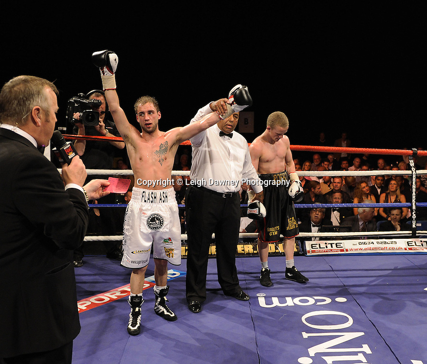 Ashley Sexton (white shorts) celebrates after defeating Mike Robinson at London's Olympia on Saturday 30th April 2011 for the 8x3 mins Flyweight contest. Matchroom Sport. Photo credit © Leigh Dawney.