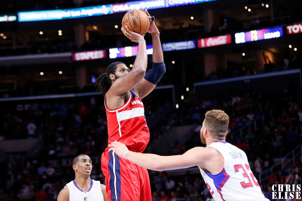 20 March 2015: Washington Wizards forward Nene Hilario (42) takes a jump shot over Los Angeles Clippers forward Blake Griffin (32) during the Los Angeles Clippers 113-99 victory over the Washington Wizards, at the Staples Center, Los Angeles, California, USA.