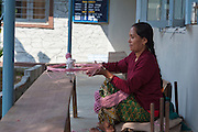 Spinning cotton into balls at Womens Skills Development Project in Pokhara, Nepal. The WSDP was set up in 1975 as a non-profit, fair trade organization to help disadvantaged women in Nepal.
