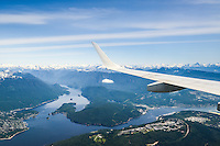 Air Canada Embraer 190 flying over Burnaby and SFU for landing at YVR