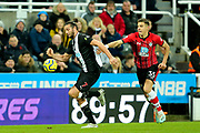 Andy Carroll (#7) of Newcastle United on the ball pursured by Jan Bednarek (#35) of Southampton during the Premier League match between Newcastle United and Southampton at St. James's Park, Newcastle, England on 8 December 2019.
