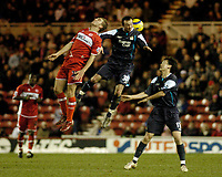 Photo: Leigh Quinnell.<br /> Middlesbrough v Manchester City. The Barclays Premiership. 31/12/2005. Middlesbroughs James Morrison jumps with Man Citys Stephen Ireland and Jihai Sun(R)