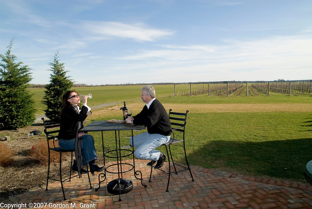 Riverhead, NY - 1/7/07 - Kristine Fitzpatrick of Dix Hills and Robert Wilkinson of Amagansett outside at Roanoke Vineyards in Riverhead, NY January 7, 2007, on a warm winters day.     (Photo by Gordon M. Grant)   .